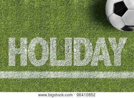 Soccer field with the text: Holiday