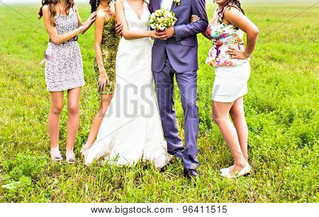 bridesmaids with groom and bride