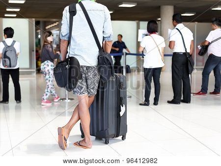 Man With Luggage Standing Waiting For Arrival Passanger In The Airport