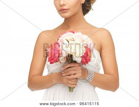 close up of young woman with bouquet of flowers.