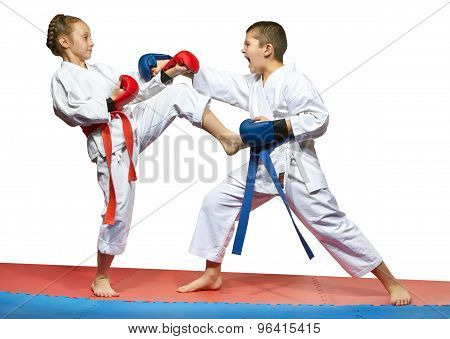 Paired exercises karate in performing athletes in karategi