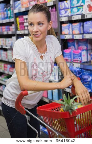 Woman buy products with his trolley at supermarket