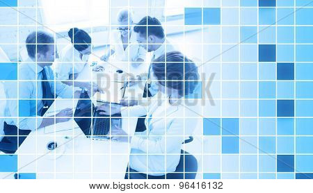 business, people and teamwork concept - business team with laptop computer and papers meeting in office over blue squared grid background