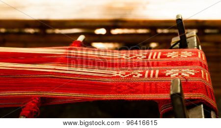 Loom With Red Textile