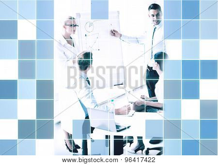 business, strategy and people concept - business people with graph on flip board at presentation in office  over blue squared grid background