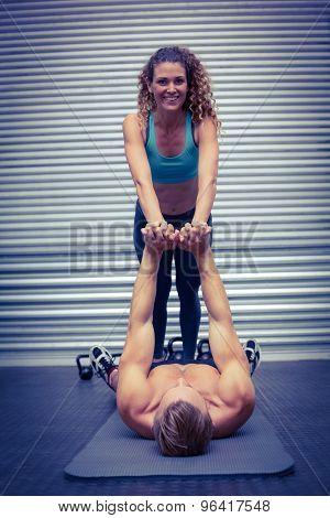 Portrait of a muscular couple doing core exercises