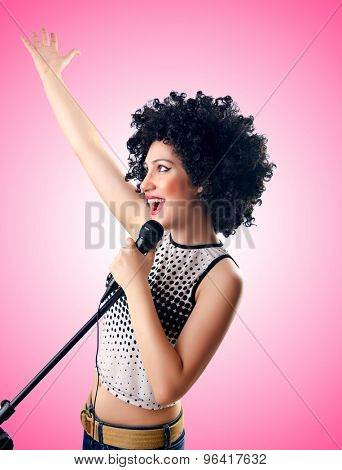 Woman with afro haircut against gradient
