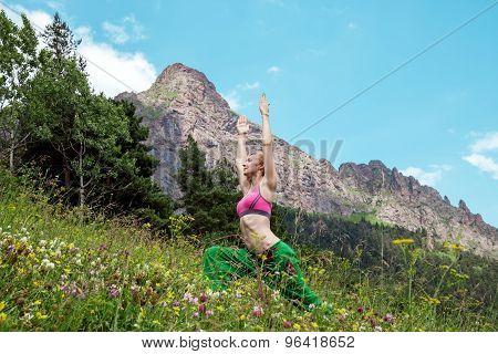 Young slim woman makes Syrya Namaskara yoga poses