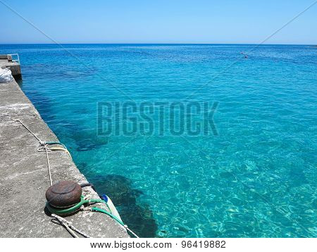 Blue Sea View In Sunny Summer Day Transparent Water At Pier