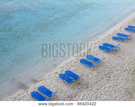 Tropical Sand Beach With Blue Empty Deckchair