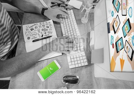 Brainstorm against casual businessman typing on keyboard