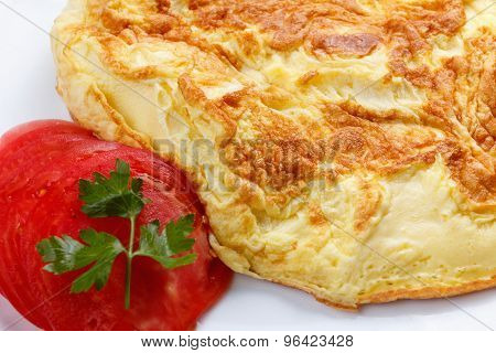 Ready To Eat Scrambled Eggs With Tomatoes And Parsley, Close-up