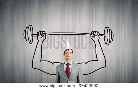 Young man with drawn strong hands lifting barbell