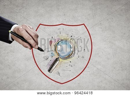 Close up of businessman hand drawing search icon