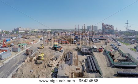 MOSCOW - MAY 25, 2015: Construction site of MKZD North-Eastern Tunnel near Shelkovskoe highway with city traffic at spring sunny day. Aerial view