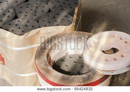 Soil briquette stove