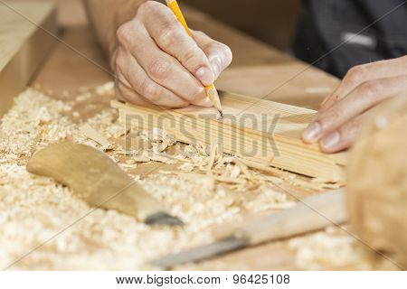 Young carpenter working with cutter in his studio