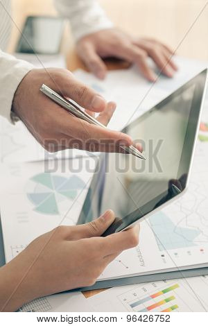 Executives with a tablet