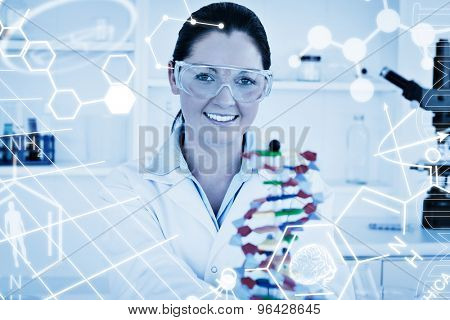 Science graphic against smiling scientist showing the dna double helix model