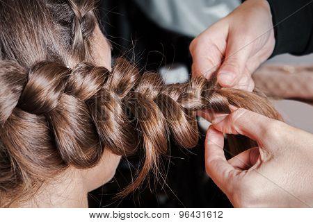 weave braids in a beauty salon