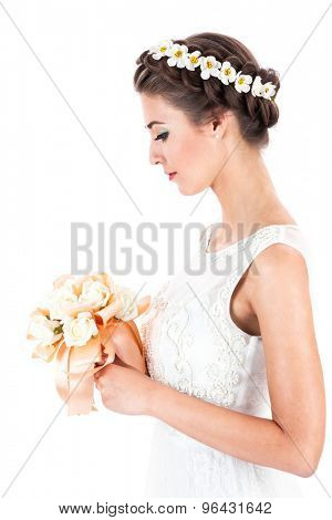 bride with a bouquet of roses on a white background