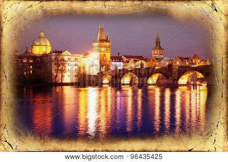 View of the Lesser Bridge Tower of Charles Bridge in Prague (Karluv Most) the Czech Republic. This bridge is the oldest in the city and very popular tourist attraction.Filtered image: vintage effect.
