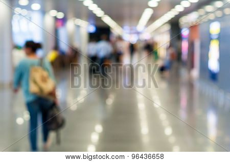Blur background : Passenger walking for flight at airport terminal blur backdrop with bokeh light.