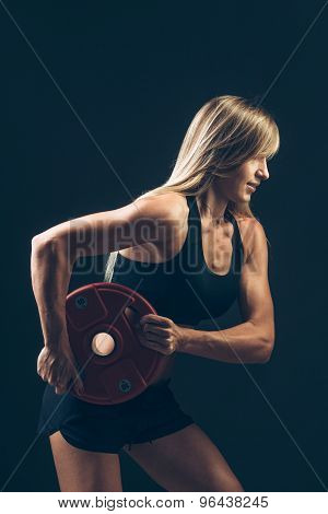 Fitness woman doing  weight training by lifting a heavy weights barbells, sports lifestyle