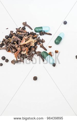 Asian dry herbals medicine and drug capsule medicine on white background