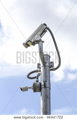 Outdoor Cctv Camera On The Pole With Blue Sky