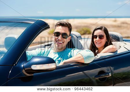 Young Man With Girlfriend In Cabriolet.