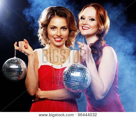 Party girls with disco ball, happy and smile.