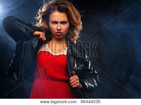 portrait of beautiful fashionable woman on dark background