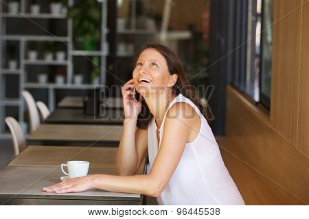 Smiling Older Woman Laughing With Mobile Phone