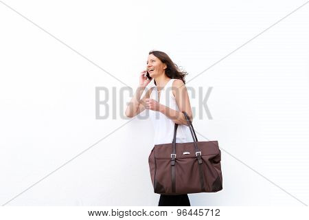 Woman Walking And Talking On Mobile Phone