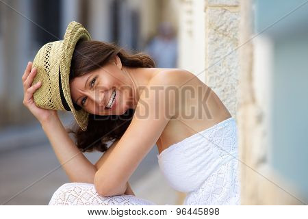 Smiling Older Woman With Hat Outside