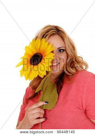 Woman Holding Sunflower For One Eye.