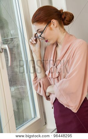 Office Woman Looking Outside Through Glass Window