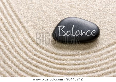 A Black Stone With The Inscription Balance