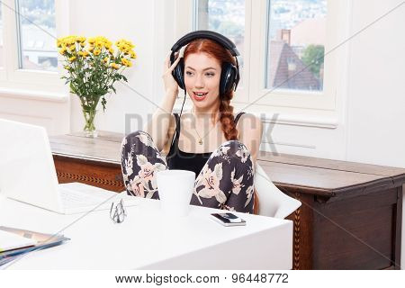 Happy Young Woman Listening Music In Her Room