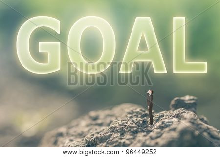 Concept of goal with a person stand in the outdoor and looking up the text over the sky in nature background.
