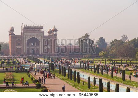 AGRA, INDIA - 28 FEBRUARY 2015: AGRA, INDIA - 28 FEBRUARY 2015: View of North side of Great Gate from Taj Mahal with visitors.
