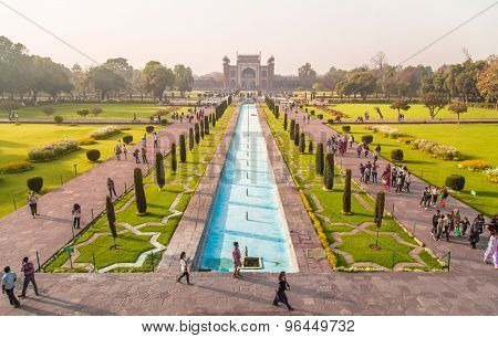 AGRA, INDIA - 28 FEBRUARY 2015: View of North side of Great Gate from Taj Mahal with visitors walking in gardens.
