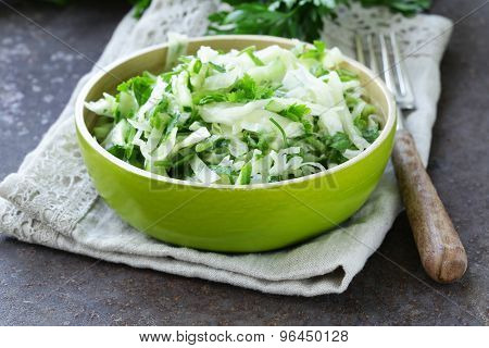 fresh green salad with cabbage (coleslaw), cucumber and parsley - healthy food