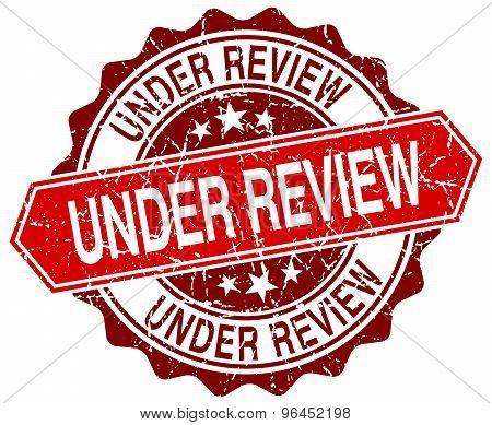 Under Review Red Round Grunge Stamp On White