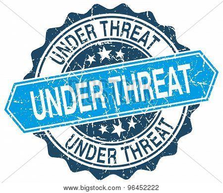 Under Threat Blue Round Grunge Stamp On White