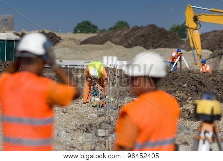 Construcyion Workers At Building Site