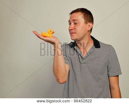man with a duck toy