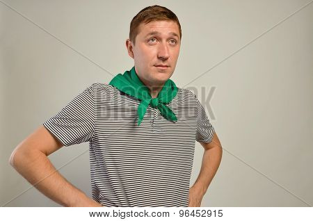 Young man hands on hips grey background