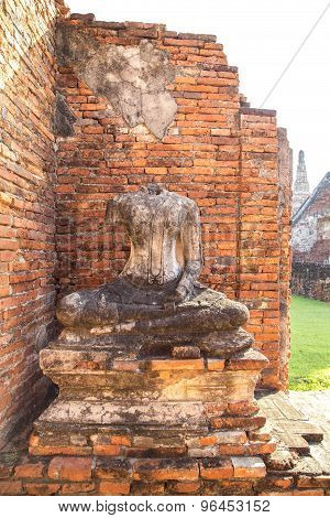 Old Buddha Statue And Orange Bricks At Chaiwatthanaram Temple
